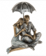 Rainy Day Romance Loving Couple Sitting Under an Umbrella 65500